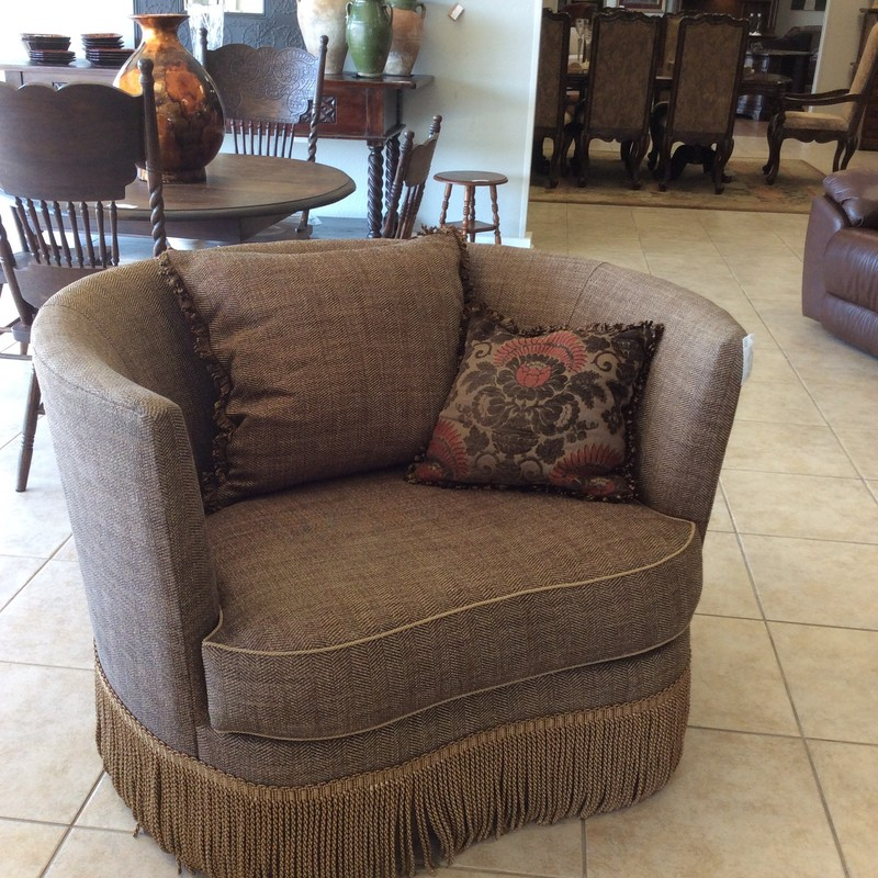This chair by Paul Roberts is gorgeous! This swiveling chair is large, wide and deep - it envelops you in comfort and style! Upholstered in a brown tweed with a bold, braided fringe and 2 accessory pillows. Best of all, we have 2 of them, priced separately.