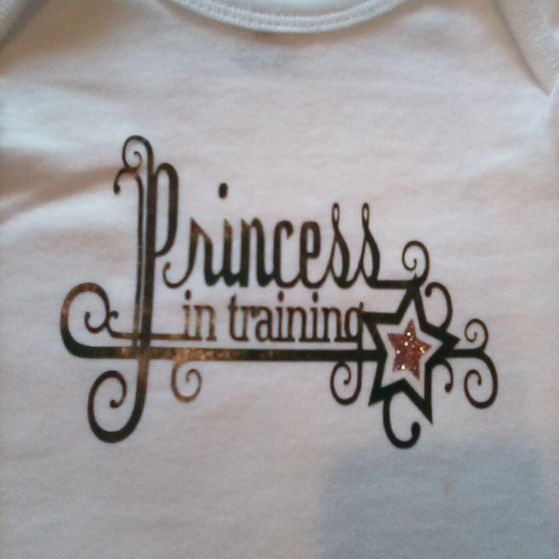 Onesie with vinyl design.  Just right for photos and playtime. 100% cotton