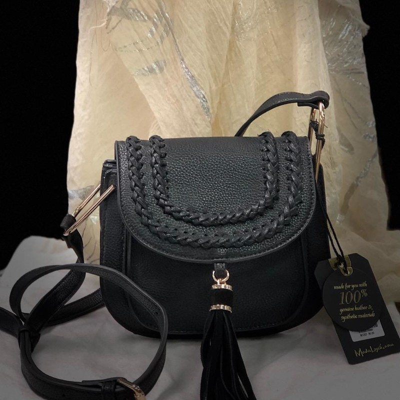 "MODA LUXE, Black NOLA, NEW w/TAGS<br /> Bag Type: Crossbody<br /> Material: Faux leather with genuine leather suede tassel<br /> Closure: Snap<br /> Exterior Details: Front Pocket and tassel<br /> Inside Features: 1 zipper pocket and 1 slip pocket<br /> Shoulder Strap Drop: 19- 22<br /> 8.5"" L x 3.5"" W x 6.5"" H<br /> MSRP: $80.00"