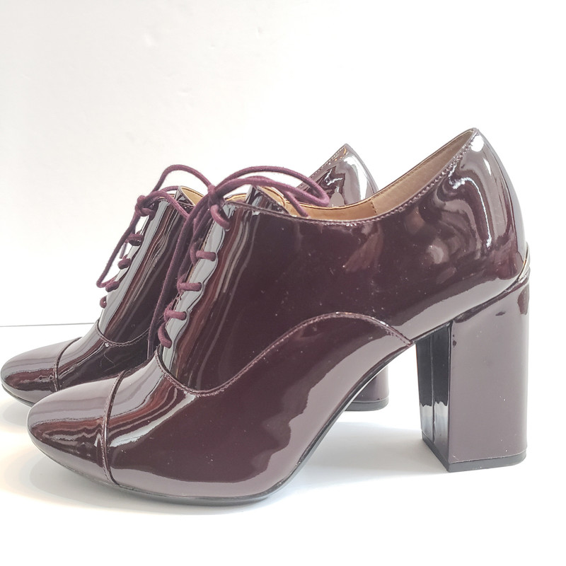 Calvin Klein<br /> Heeled Oxford<br /> Oxblood Patent<br /> Size: 9.5