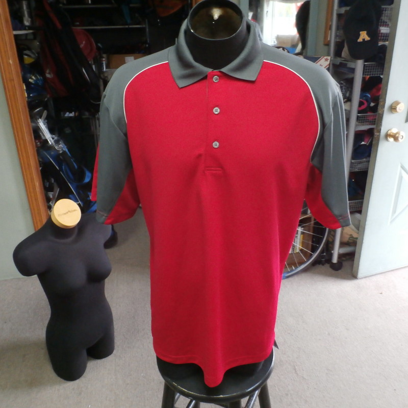 "Rating: (see below) 3- Good Condition<br /> Team: N/A<br /> Player: N/A<br /> Brand: PGA TOUR<br /> Size: Men's - Large (Measured Flat: chest 23"", length 30"")<br /> Color: Red<br /> Style: Short sleeve Polo; Embroidered logo<br /> Material: 100% Polyester<br /> Condition: 3 - Good Condition; wrinkled; material looks and feels good; black mark on the top of the left shoulder; some light snags; signs of use; no rips or holes"