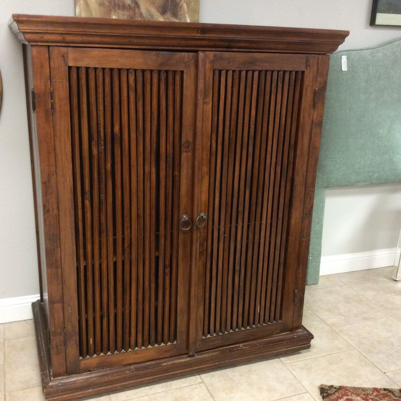 This handsome cabinet could actually be used for almost anything. The consignor had her crystal and china in it, but it also has openings in the lower back to accommodate various media cords. It is solid wood and has a pretty mahogany finish.