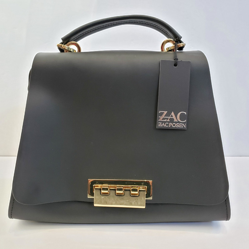 Zac Posen<br /> Black Purse<br /> Original Retail $495<br /> Gold Hardware<br /> Includes Long Strap<br /> NWT