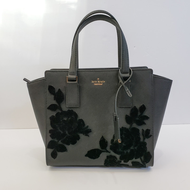 Kate Spade<br /> Black Purse with Black Flower Detail<br /> Long Strap Included<br /> Dust Bag Included