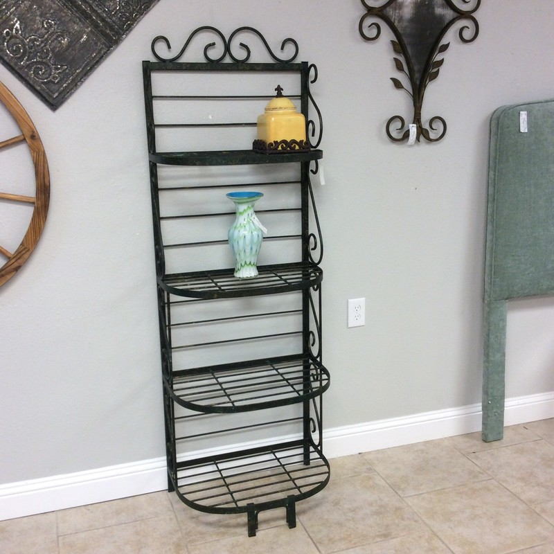 "This adorable bakers rack would be perfect in a smaller space! It's tall but not very wide at only 24"". It features 4 tiers, has been painted black and is adorned by lovely scrollwork on both the sides and the top. Priced well too!"