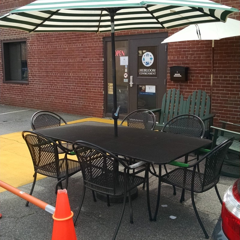 Black Metal Table with Six Chairs<br /> Green and White Umbrella and Stand included!