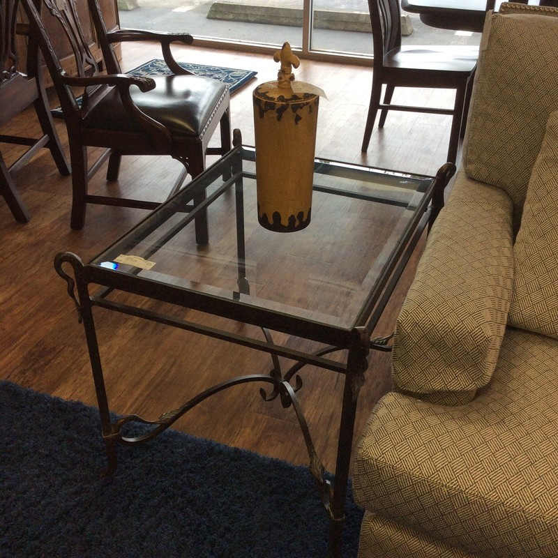 Sleek and modern would describe this end table! It represents a lovely combination of metal and glass and it's in great condition. Best of all, it comes with a matching sofa table priced separately.