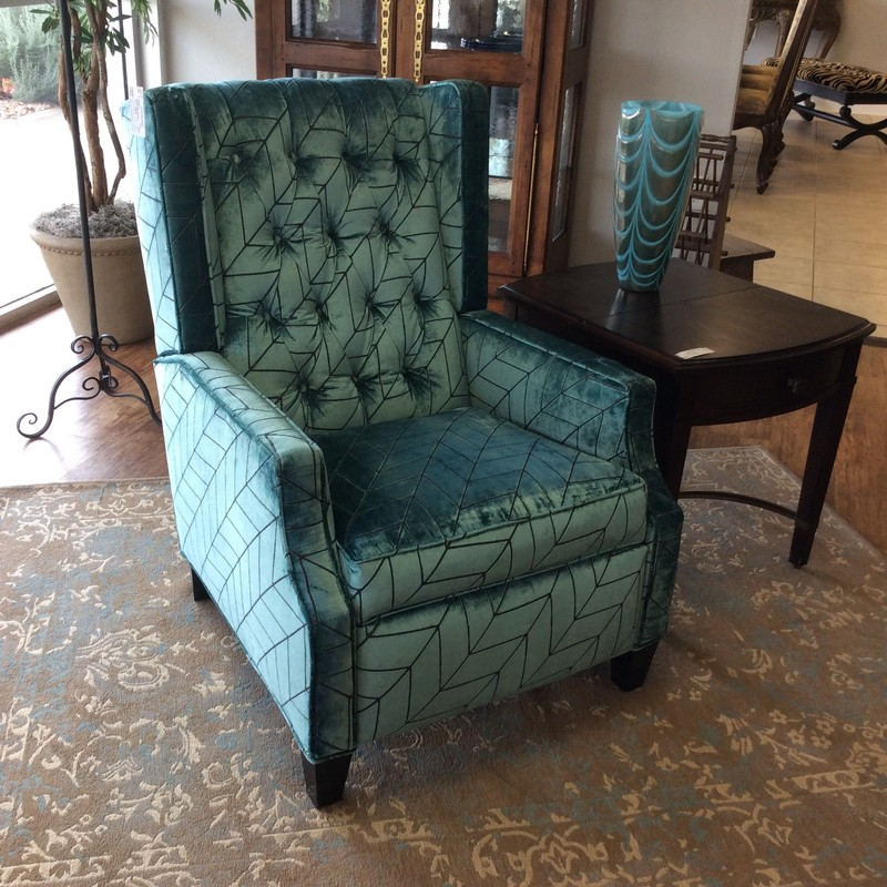 This recliner by Sam Moore which is part of Hooker Furniture is fabulous! It features a vibrant teal and brown geometric pattern. This recliner is a fresh update to a classic!  Manual operation.