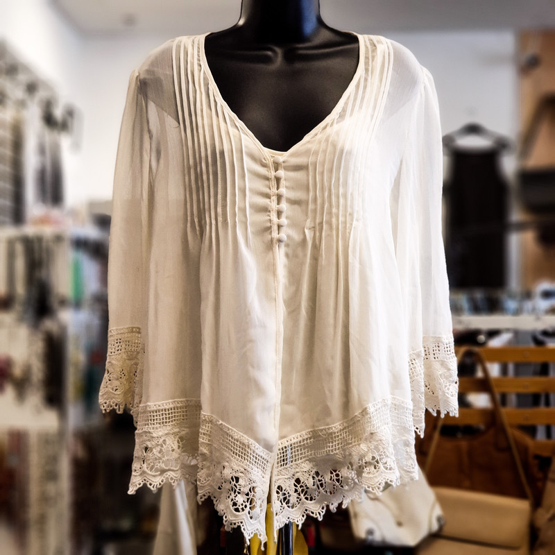 Beautiful Adiva Top.<br /> - Brand new<br /> - Off white color with lace details<br /> - Stretchy tank top<br /> - Flowy<br /> - Bust circumference: 40 in.<br /> - Length: 26 in.<br /> - Sleeves length: 19 in.<br /> - Size Large<br /> <br /> * Please note that these measurements and pictures are for reference only and may vary slightly from the original.