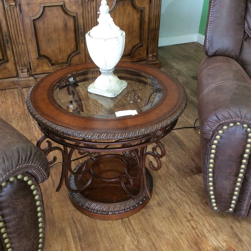 This side table is a beautiful combination of metal, glass and wood. The painted and antiqued metal base features flowing scrollwork. It definitely has a vintagy feel to it.