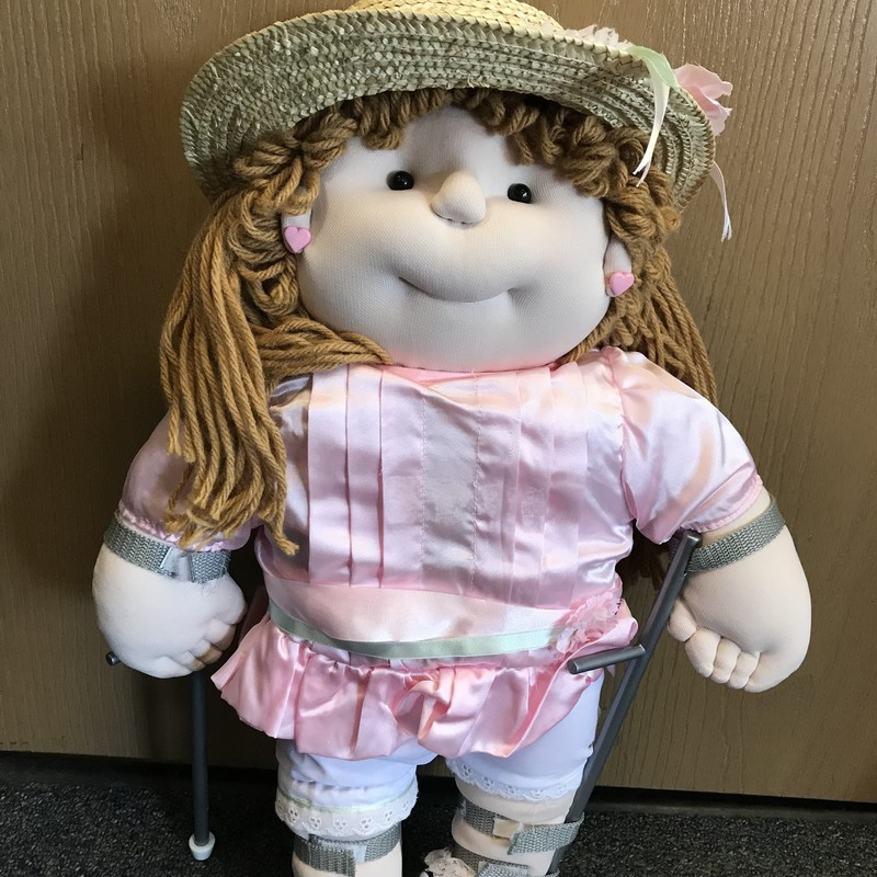 "21"" soft doll with yarn hair, hat, with removable leg braces and crutches. In great condition! NO SHIPPING"