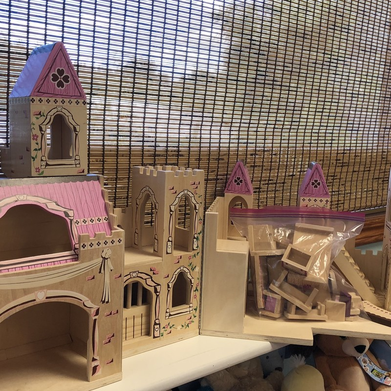 Melissa and Doug Wooden Castle with accessories and people.  Your child will have fun for hours playing with this gem.