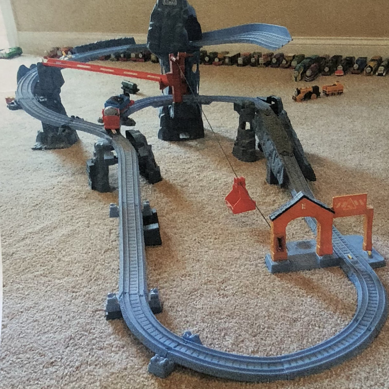 Thomas the Train Risky Rails Bridge Drop set. This set comes with an engine and train car.  This set is not wood, it is plastic.