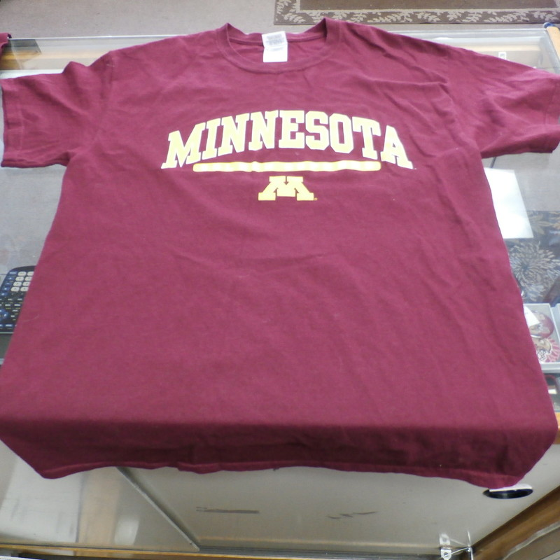 "Minnesota Golden Gophers Gildan Adult Short Size Medium Maroon #23906<br /> Rating: (see below) 3 - Good Condition<br /> Team: Minnesota Golden Gophers<br /> Player:  n/a<br /> Brand: Gildan<br /> Size : Adult - Medium( Measures Chest 19"" ; Length 27"")<br /> armpit to armpit; shoulder to hem<br /> Color: Maroon<br /> Style: short sleeve; screen pressed logo<br /> Material: 100% Cotton<br /> Condition: 3 - Good Condition; wrinkled; material looks and feels good; light pilling and fuzz; light stains on the left side of the back; normal signs of wear; no rips or holes<br /> Item #: 23906<br /> Shipping: FREE"