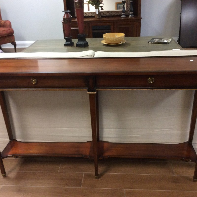This sofa table by Sherrill Occasional  Furniture is of the finest quality - hand crafted right here in the United States. Constructed of solid wood with a mahogany veneeer and distressing for that timeless, vintagy look. Traditional in style with clean, sleek lines and includes 2 drawers.