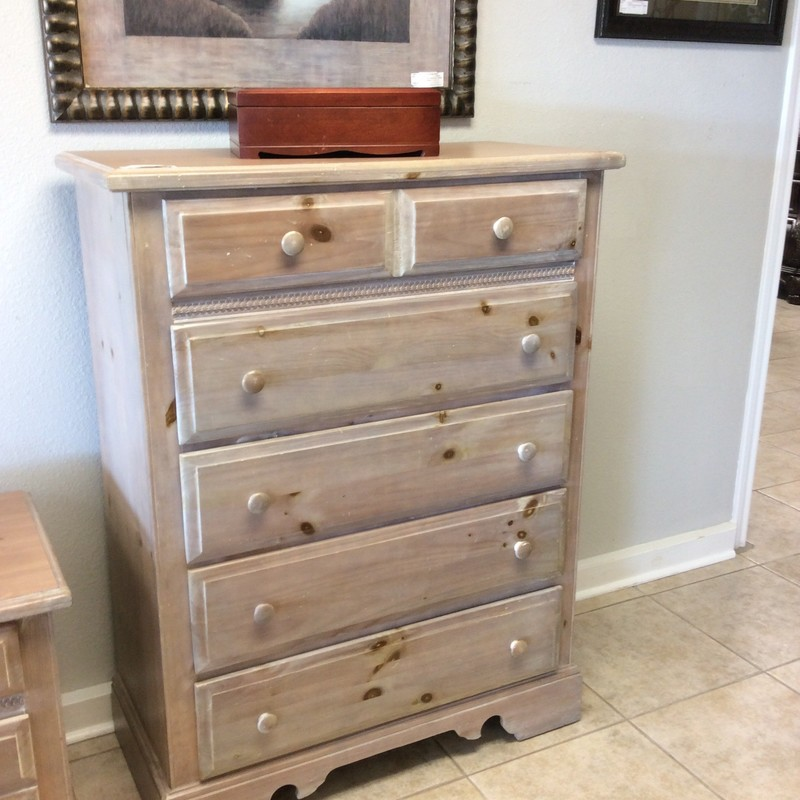 This pine dresser includes 5 drawers and has been painted and distressed. There's a matching pair of nightstands priced separately.