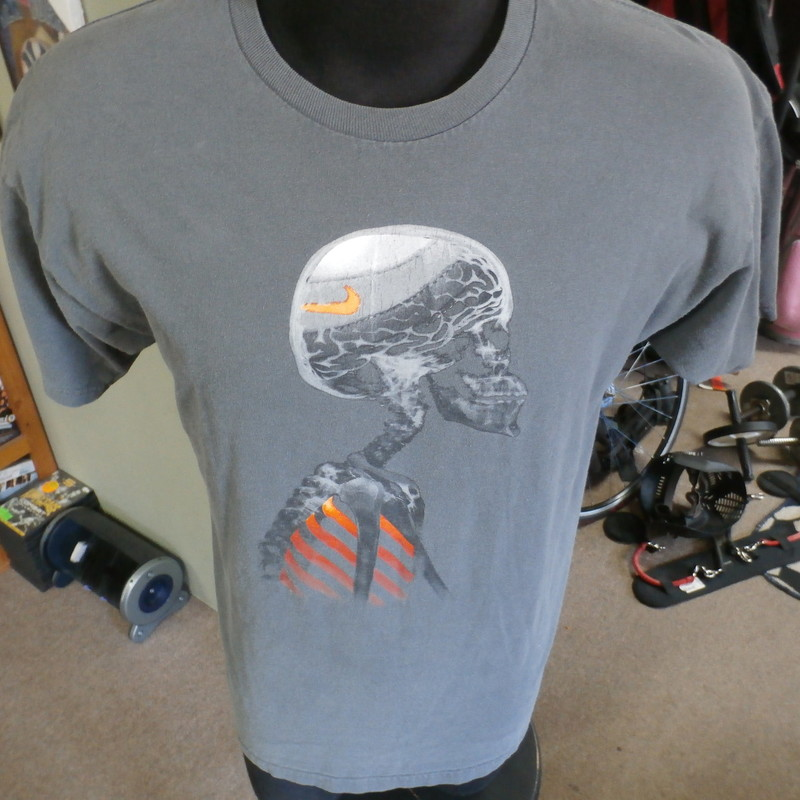"Nike X-ray Skeleton shirt gray size large 100% cotton #23895<br /> Rating: (see below) 3-Good Condition<br /> Team: n/a<br /> Player: n/a<br /> Brand: Nike<br /> Size: Men's Large  (Measured: 21"" Wide, length 28"")<br /> Measured: Armpit to armpit; shoulder to hem<br /> Color: gray<br /> Style: short sleeve; screen printed<br /> Material: 100% cotton<br /> Condition: 3- Good Condition; wrinkled; some pilling and fuzz; material is stretched and worn from wearing and washing; some discoloration and fading; no rips or tears; no stains; screen printing is slightly cracked and starting to fade  (see photos)<br /> Item #: 23895<br /> Shipping: FREE"