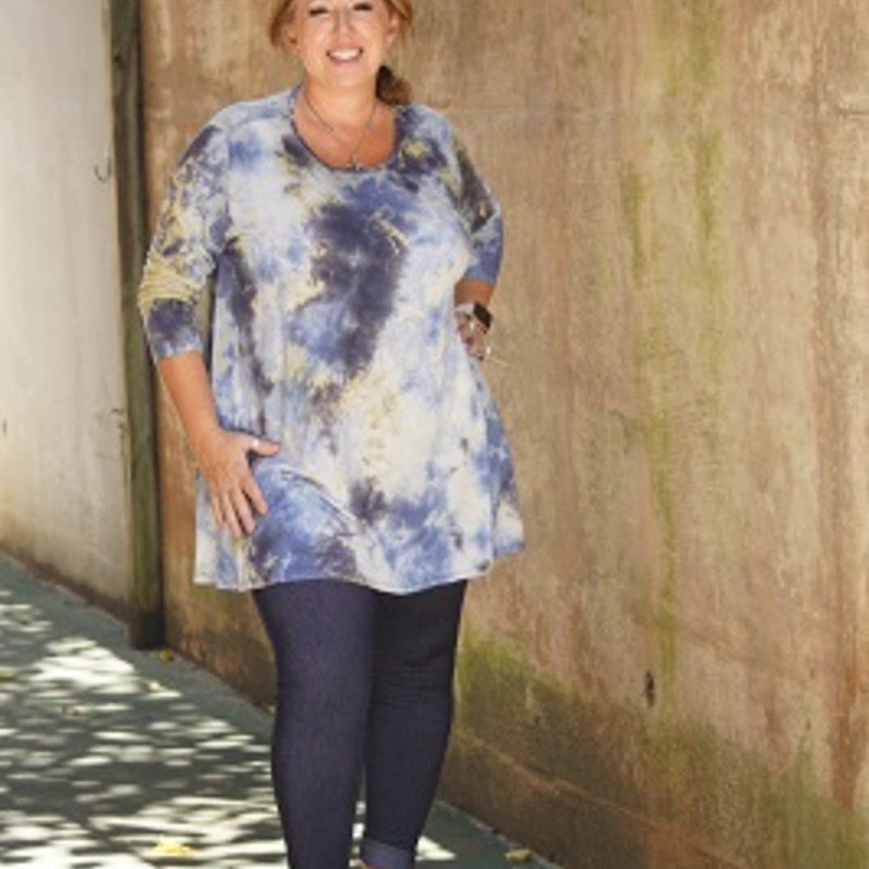 Anne looks beautiful in our tye dye tunic that just came in. The blues and yellows just make the top pop. its made of 95% rayon, 5% Spandex with a length of 33in.