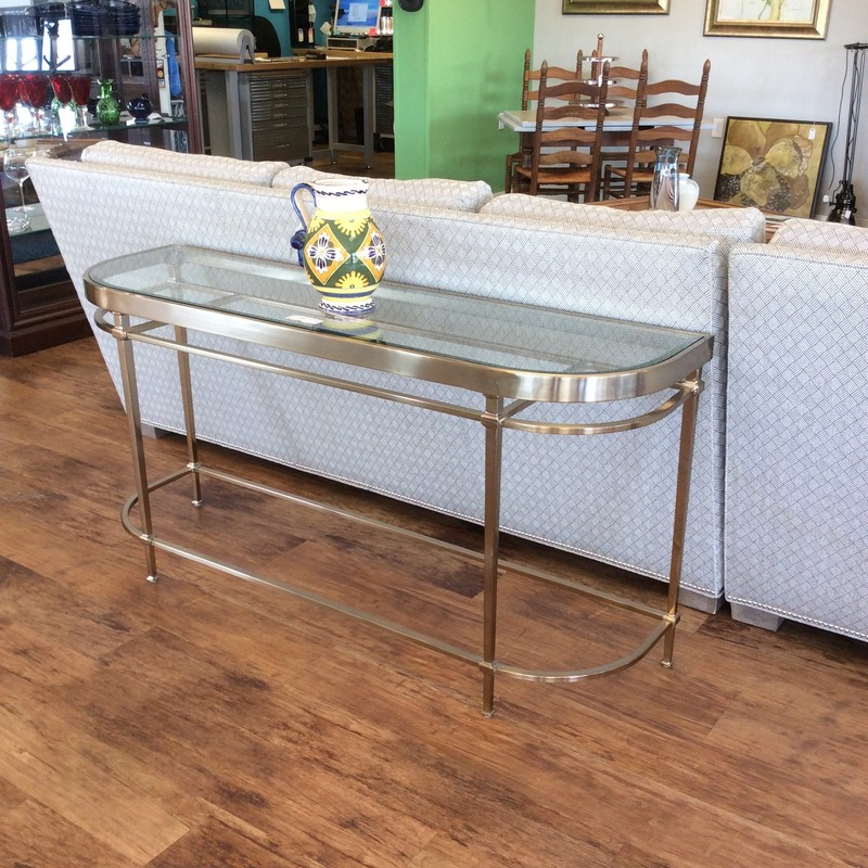 This sofa table is a beautiful combination of brass and glass. Modern and sylish in design, this sofa table would add a touch of glam to your room. Best of all, there's a matching coffee table priced separately.