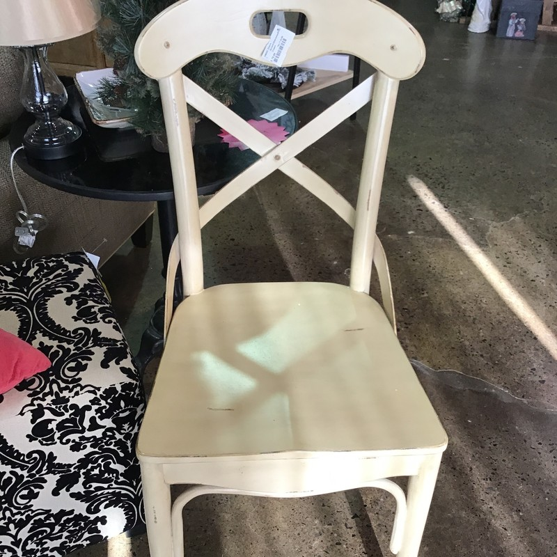 Pull up a seat with this handsome distressed cross back chair designed with comfort and beauty in mind.  Painted in a buttery cream paint and then factory distressed<br /> <br /> Matches #106032