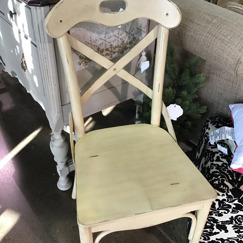 Pull up a seat with this handsome distressed cross back chair designed with comfort and beauty in mind.  Painted in a buttery cream paint and then factory distressed<br /> <br /> Matches #106033