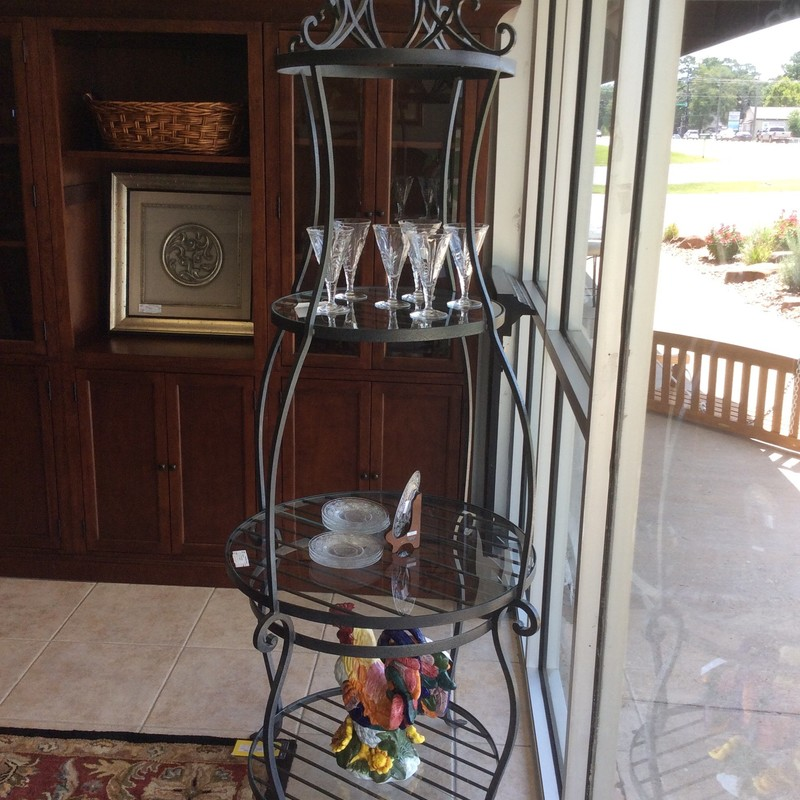 Well isn't this a cute stand! It is made entirely of wrought iron that has a pretty, dimpled, gray finish. The iron shelves each have a removable, 2-piece (semi-circles) glass topper.