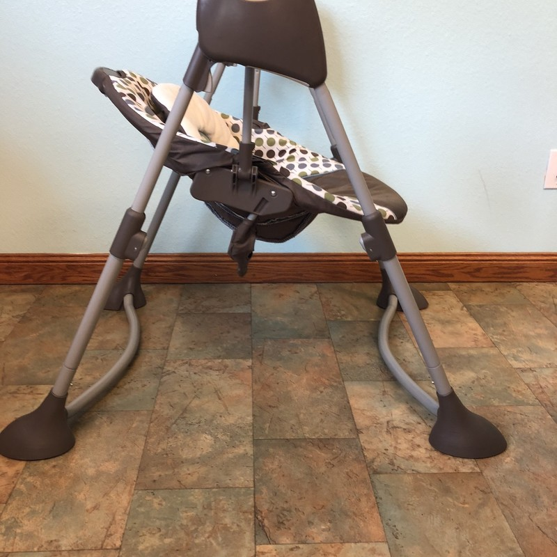 Graco Swing. This swing folds up small, adjusts up and down and reclines.  This swing is battery operated and is quiet.  Perfect for smaller areas and even travel.