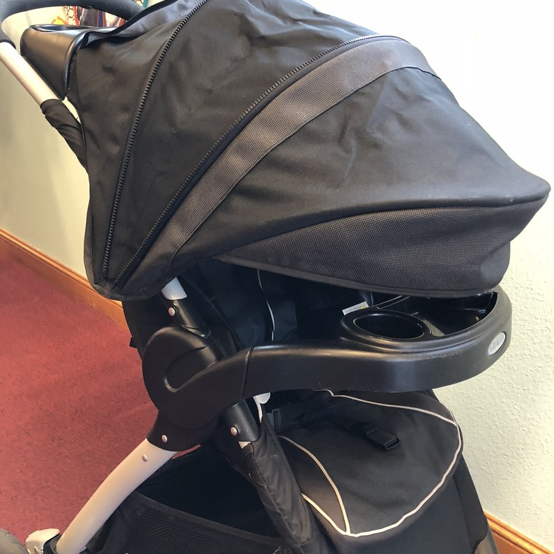 Graco Jogging Stroller. This stroller reclines into several positions and has an extra large sun shade. It has a front snack tray/cup holder and a snack tray/cup holder for parents.