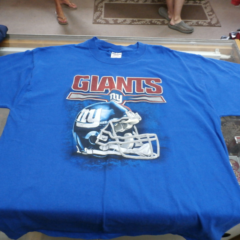New York Giants Jerzees Men&#039;s Short Sleeve Shirt Size Large Blue Cotton #24635<br /> Rating: (see below) 3- Good Condition<br /> Team: New York Giants<br /> Player: N/A<br /> Brand: Jerzees<br /> Size: Men&#039;s- Large(Measured: Across chest 21&quot; , length 29&quot;)<br /> Measured: Armpit to armpit; shoulder to hem<br /> Color: Blue<br /> Style: short sleeve; screen pressed<br /> Material: 100% Cotton<br /> Condition: 3 - Good Condition - wrinkled; material looks and feels good; pilling and fuzz; feels coarse; no stains rips or holes<br /> Item #: 24635<br /> Shipping: FREE