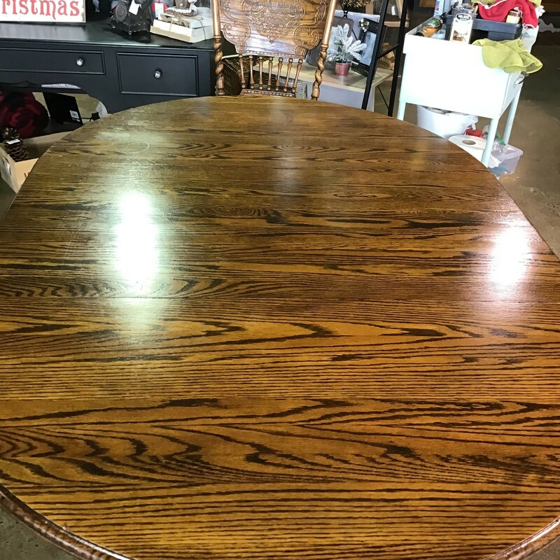 "This beautifully crafted dark oak table was made by the Amish and can be round or oval. It has gorgeous turnings on the chairs and a clawfoot pedestal base. This is a great set for your kitchen or dining space.<br /> Dimensions without leaf are 48"" x 31""<br /> Dimensions with leaf are 70"" x 48"" x 31"""