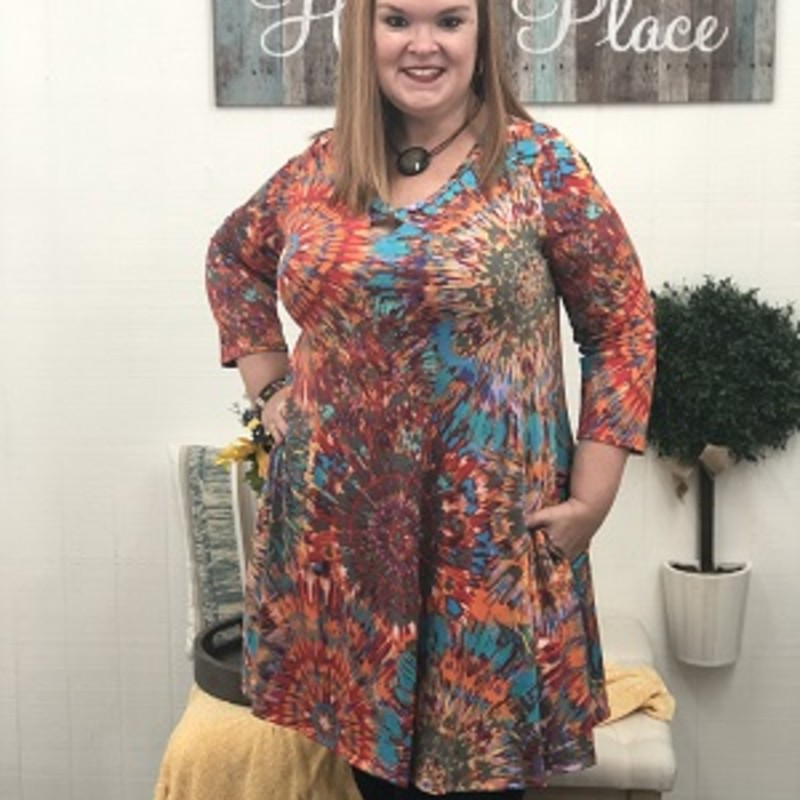 Tonya looks stunning in our Criss Cross Tye Dye Pocket Dress! This Dress would stand out anywhere you go, the mixture of colors just pop. The material is made of 92% Polyester 8 % Spandex and has a length of 36in.
