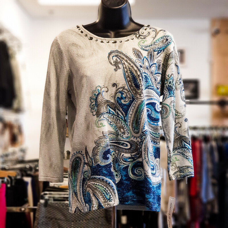 Beautiful Alfred Dunner Top.<br /> - Brand new<br /> - Gray, teal, blue, green and taupe color<br /> - Paisley print<br /> - Glitter details<br /> - Crystals neck details<br /> - Stretchy<br /> - Bust circumference: 36 in.<br /> - Length: 24 in.<br /> - Sleeves length: 18 in.<br /> - Size SmallP<br /> <br /> * Please note that these measurements and pictures are for reference only and may vary slightly from the original.