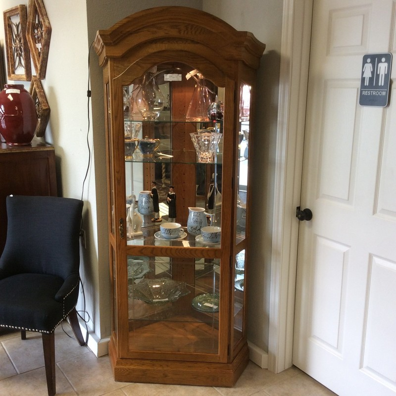 These corner-unit curios never stay in the store for very long. This one is a PULASKI and features solid oak construction, 4 adjustable glass shelves, internal lighting and a single glass door.