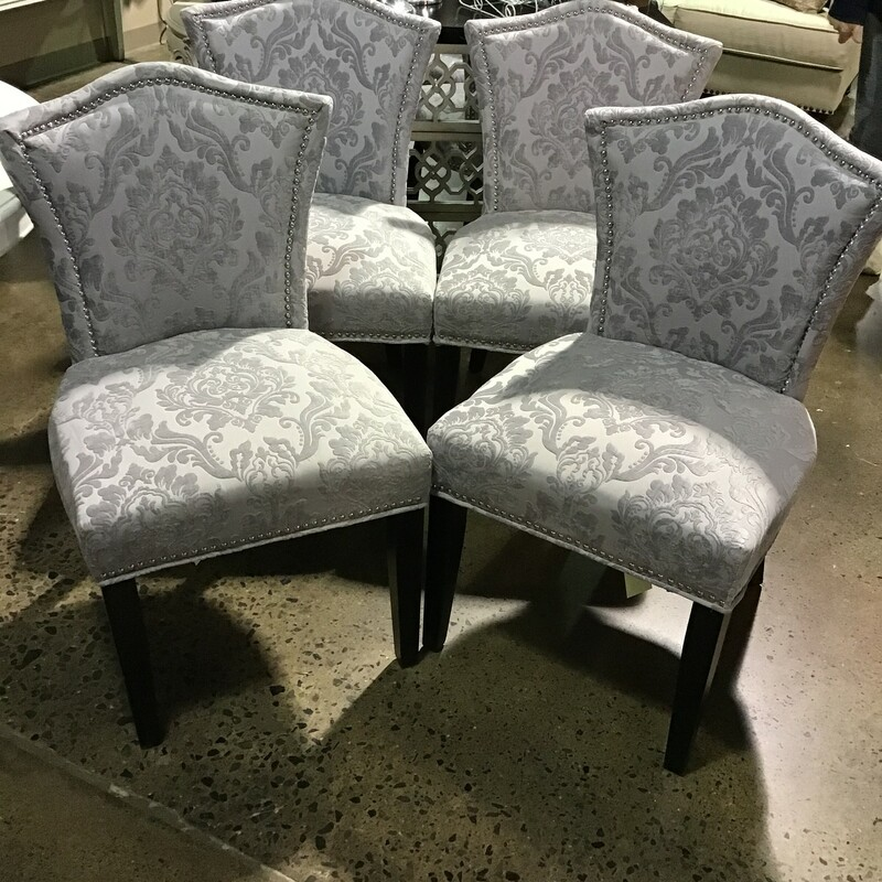 "Absolutely beautiful set of four grey patterned upholstered chairs with silver nail brad trim.<br /> <br /> Dimensions:  21""W x 21""D x 36.5""H"