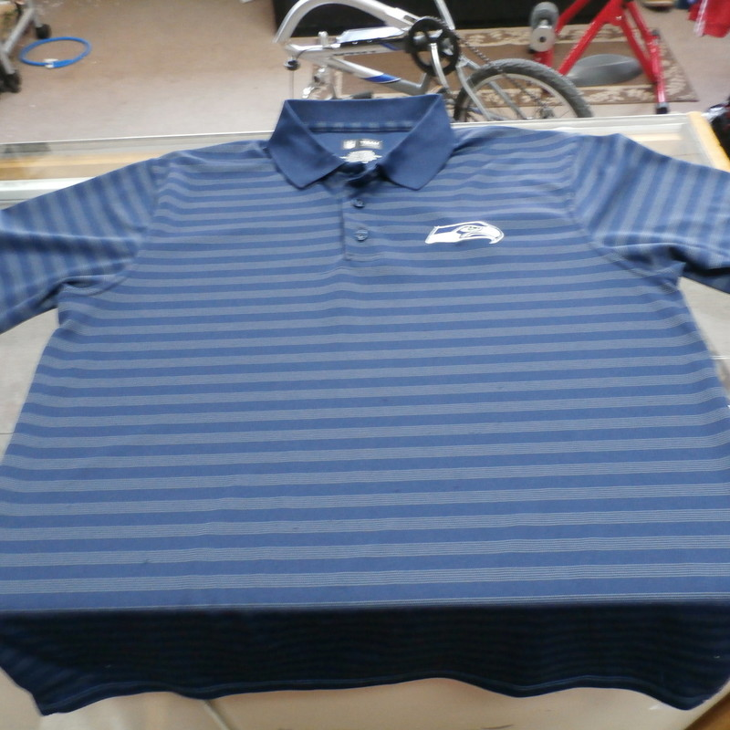 Seattle Seahawks Team Apparel Men&#039;s Short Sleeve Polo Shirt Size XL Blue #24854<br /> Rating: 3 - Good Condition<br /> Team: Seattle Seahawks<br /> Player: N/A<br /> Brand: Team Apparel<br /> Size: XL - Adult(Measured Flat: Across chest 23&quot;;  Length 30&quot;)<br /> measurements:  armpit to armpit &amp; shoulder to hem; - please check measurements.<br /> Color: Blue<br /> Style: short sleeve embroidered polo shirt; striped<br /> Material: 100% Polyester<br /> Condition: 3 - Good Condition - wrinkled; material looks and feels good; snags throughout the front and back; missing top button at the collar; no stains rips or holes<br /> Item #: 24854<br /> Shipping: FREE