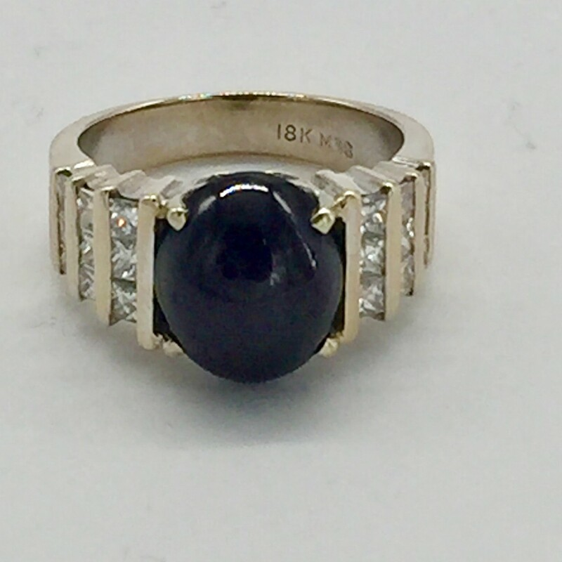 18KT WG<br /> GOLD WEIGHT 6.5DWT<br /> 5CT OVAL CAB STAR GARNET 4 RAY<br /> DIAMOND WEIGHT 7/8CTTW PRINCESS CUT DIAMONDS.<br /> FINGER SIZE 7.5<br /> (CAN BE RESIZED)<br /> <br /> <br /> 18KT Wg 5ct Star Garnet 7, White, Size: BLKH