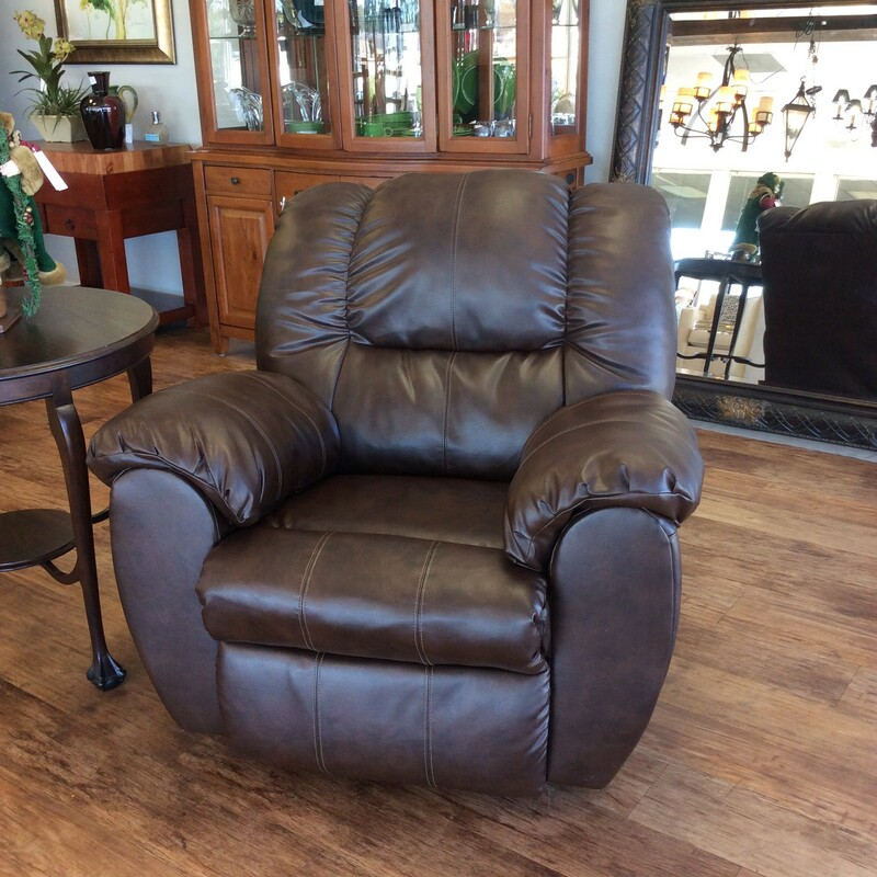 Large and overstuffed, this is the pefect recliner for social distancing! Upholstered in a rich, dark brown vinyl it both reclines and rocks. How cool is that! Manual operation and it's in great condition. Best of all, it's priced well! Come on by, these don't last long!