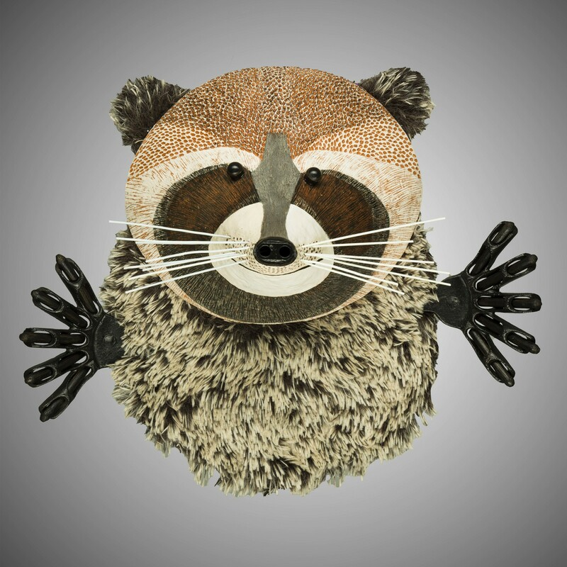 "Title: Raccoon<br /> Artist: Barbara Kobylinska<br /> Size: 17""H x 20""W x 8""D<br /> Medium: Mixed Media<br /> Description: Wall piece made of clay, fur and variuos recycled metal pieces."