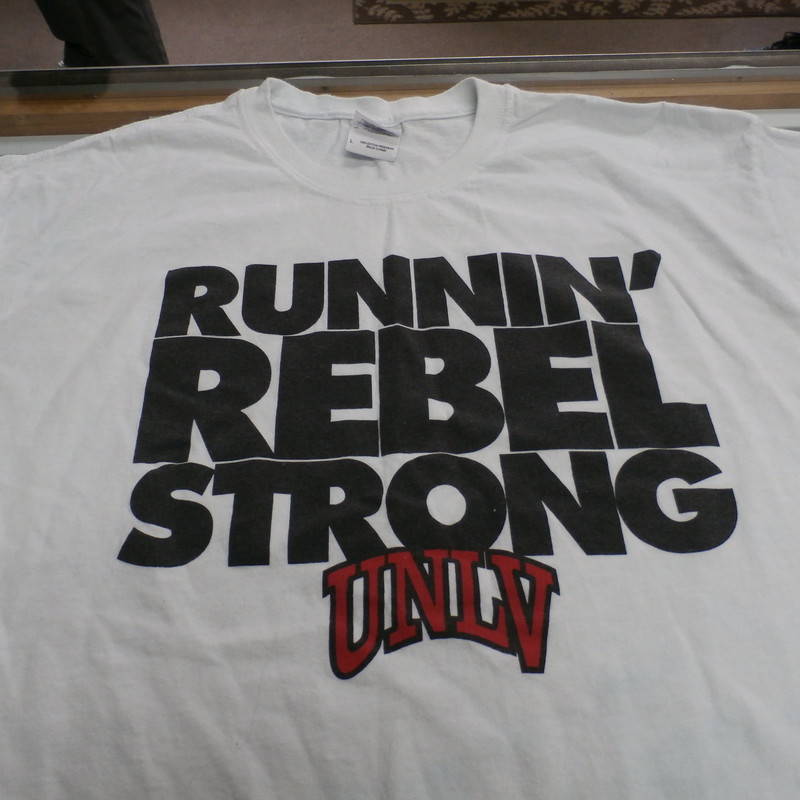 "UNLV Rebels ""Running Rebel Strong"" Gildan Adult Shirt Size Large White #23905<br /> Rating: (see below) 3 - Good Condition<br /> Team: UNLV Rebels<br /> Player: n/a<br /> Brand: Gildan<br /> Size: Adult Large - (Measured Flat: chest 20"", length 30"")<br /> Color: White<br /> Style: short sleeve; screen pressed<br /> Material: 100% Cotton<br /> Condition: 3 - Good Condition - wrinkled; material is stained blue throughout; pilling and fuzz; material feels coarse; material is lightly stretched; definite signs of use; no rips or holes<br /> Item #: 23905<br /> Shipping: FREE"