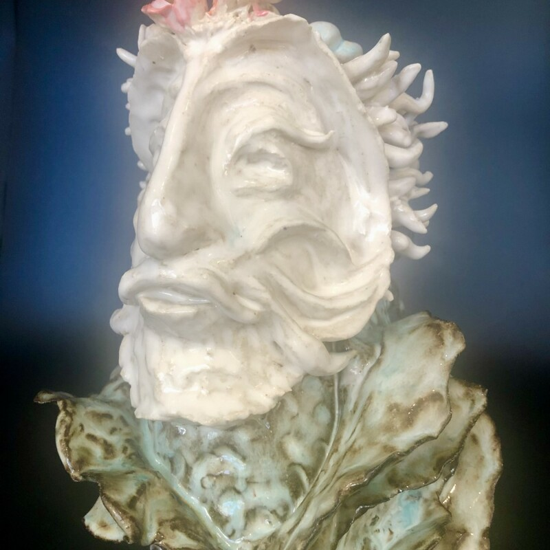 Title: Thereus<br /> Artist: David Gwaltney<br /> Size: 10x7x7<br /> Medium: Clay<br /> Statement: Ocean Reef Series...Hand built vase... Thereus, the mythical King and founder of Athens, He was challenged by KIng Minos of Crete to return his ring that he threw in the sea. He dived in a was lead  by a pod of dolphins to the Sea Goddess, Thetis. She gave him the ring and a jeweled crown. He returned the ring to MInos and kept the Crown for himself.