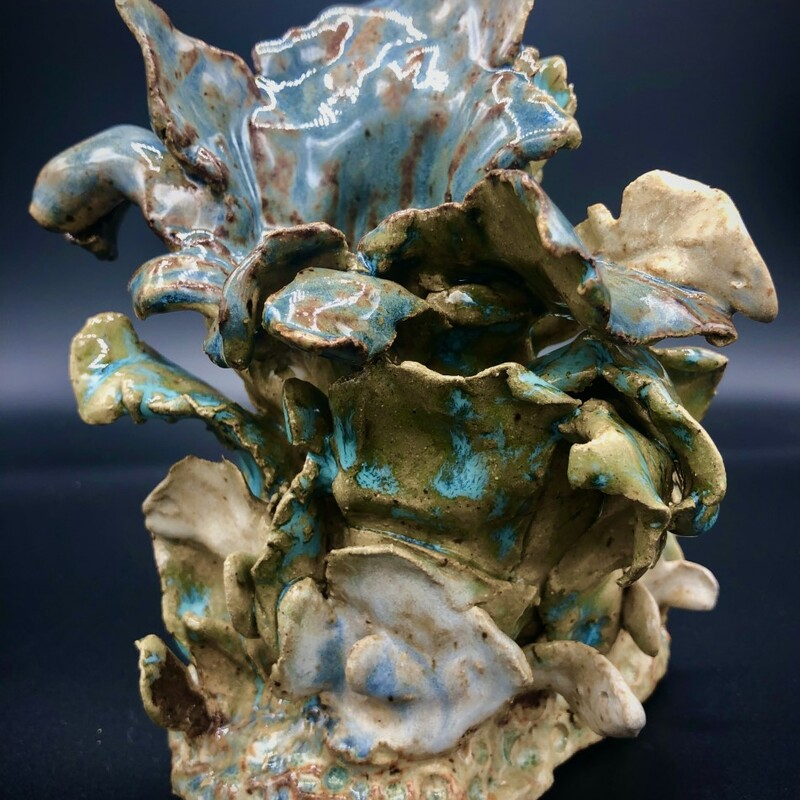 "Title: Ocean Lily<br /> Artist: David Gwaltney<br /> Size:7x5x5""<br /> Medium: Clay<br /> Statement: Coral Reef Series,  Brown and White Clay hand built sculpture, Various glazes. Fffired Cone 6"