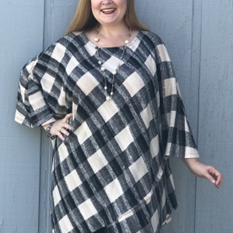 Purchase our new arrived Emerald Checker Print Tunic. It is super cute and will keep you wrm through they fall and chilly weather. you can wear this tunic anywhere, its made of 78% Polyester,18% Rayon,4% Spandex and has a length of 37in.