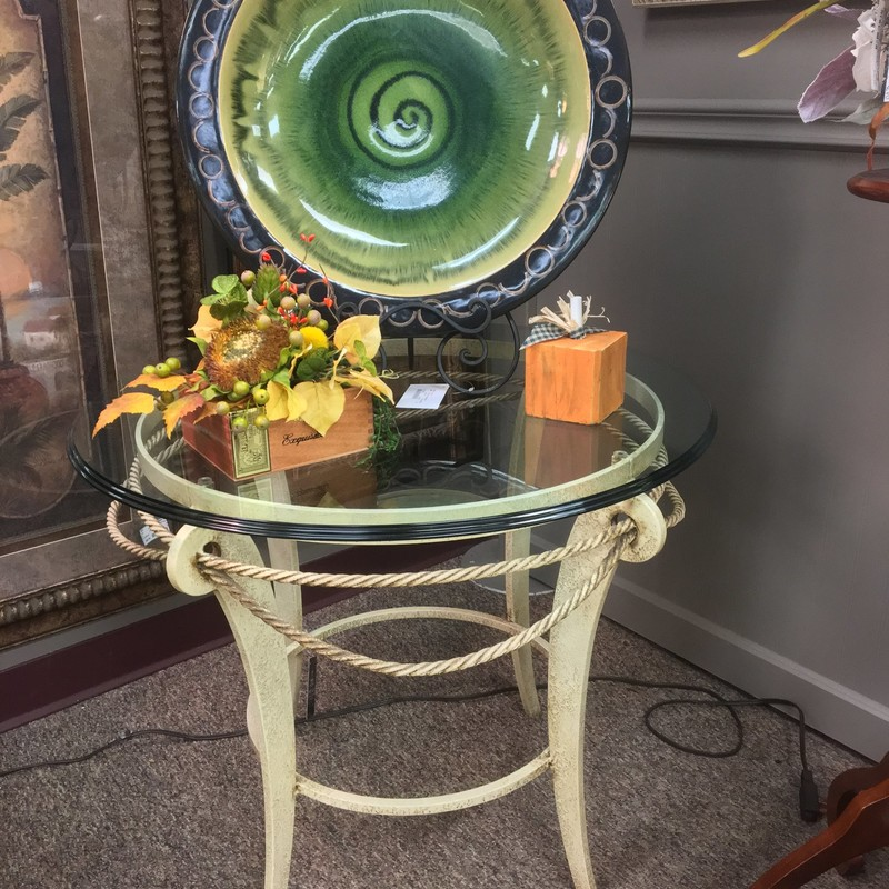 A modern, yet shabby chic glass top end table.