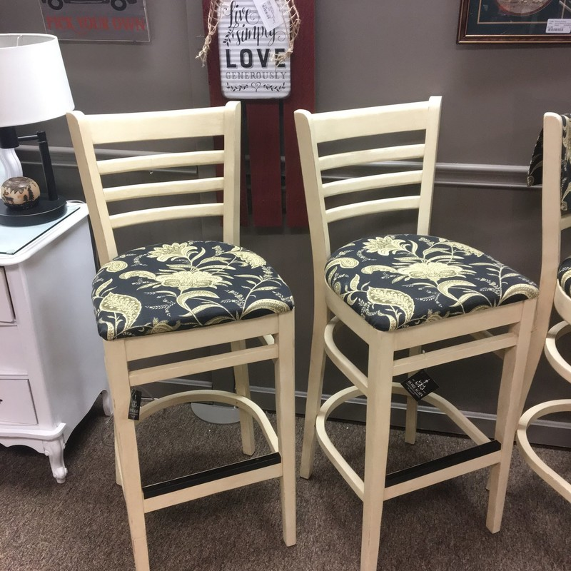 We have four of these repurposed, sturdy bar stools that each come with its own matching placemat!