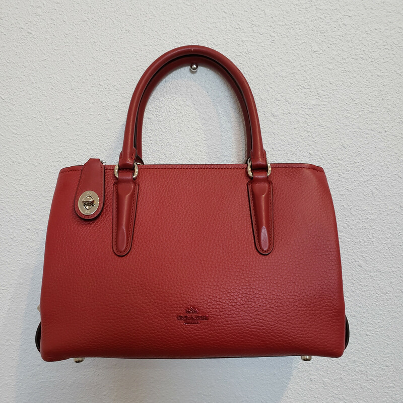 Coach<br /> Red Leather Handbag<br /> Comes with a Long Strap<br /> Zipped Center Pocket and 2 Outside Pockets