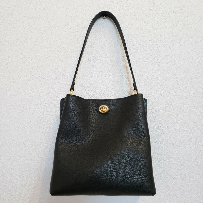 Coach<br /> Black Leather Charlie Bucket<br /> 2 Turnlock Closures<br /> Gold Hardware