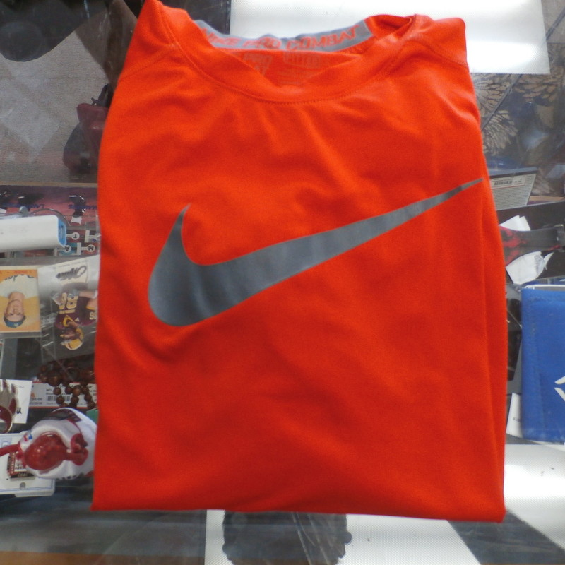 Title: Nike Pro Combat YOUTH long sleeve orange size Medium #24155<br /> Our Clothes Rating: 3- Good Condition<br /> Brand: Nike<br /> size: YOUTH Medium- (Across chest: 15&quot; Length: 22&quot;)<br /> color: orange<br /> Style: fitted shirt; long sleeve; screen pressed logo<br /> Condition: 3- Good Condition - light pilling and fuzz; tiny snag on the back; logo is cracked and worn; wrinkles<br /> Shipping: FREE<br /> Item #: 24155