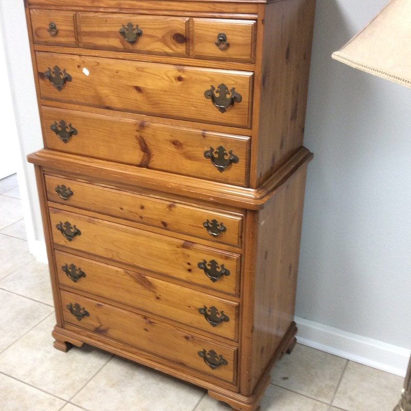 This solid wood pine chest of drawers has seen some wear but is well built and sturdy. It features 7 drawers with brass hardware. Has been priced to move, come take a look!