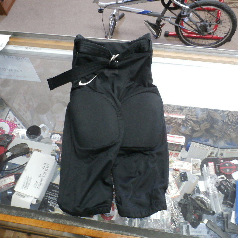 Nike YOUTH Football pants black size small thigh,tail, hip pads polyester #24811<br /> Rating: (see below) 3 - Good Condition<br /> Team: n/a<br /> Event: n/a<br /> Brand: Nike<br /> Size: YOUTH - Small  -  (measures: waist laying flat: 12; length: 20&quot;; inseam: 13&quot;)<br /> Color: Black<br /> Style: football pants with thigh pads; hip pads; tail pad; belt; missing knee pads<br /> Material: 100% polyester;<br /> Condition:  3 - Good Condition;  wrinkled; snag on the butt; clean and crisp<br /> Item #: 24811<br /> Shipping: FREE