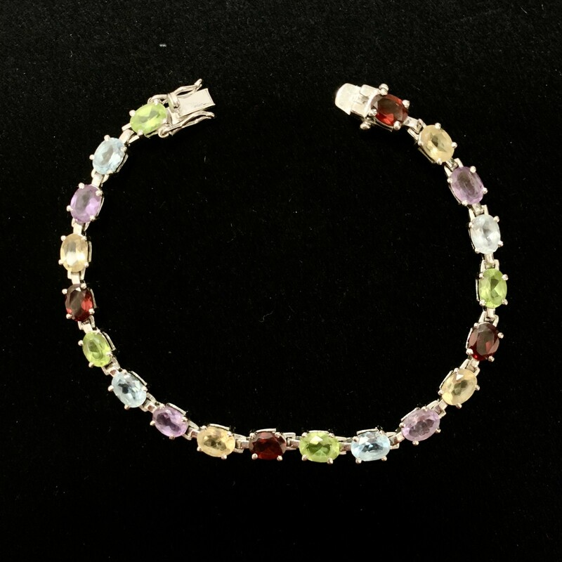 .925 Sterling Silver 7 Inch Rainbow Semi Precious Stone Bracelet<br /> <br /> Add a splash of color to your outfit with this vibrant multi gemstone bracelet.<br /> <br /> Featured Stones:  Amethyst, Aquamarine, Peridot, Citrine & Garnet<br /> <br /> Size: 7.5""